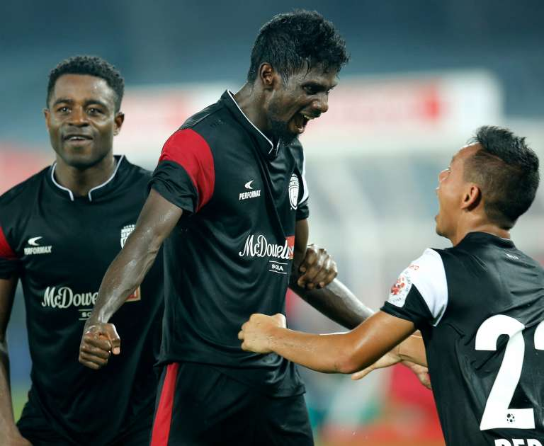 Rowllin Borges of Northeast United FC celebrating the victory with team players in Hero ISL