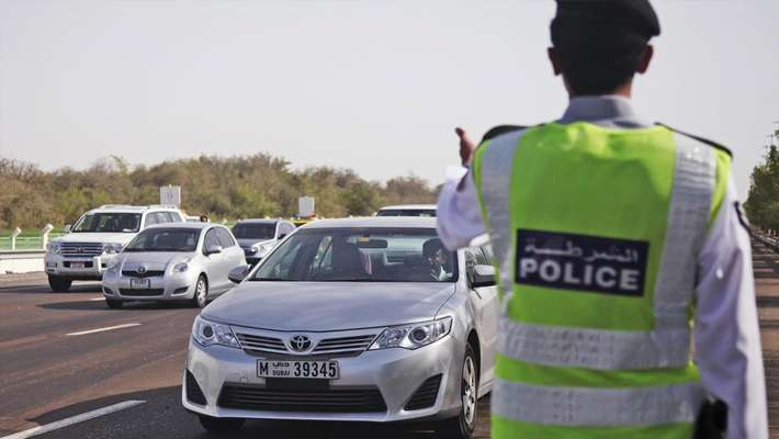 abu dhabi traffic rule violation compensation